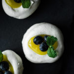 meringue cookies filled with lemon curd and blueberries