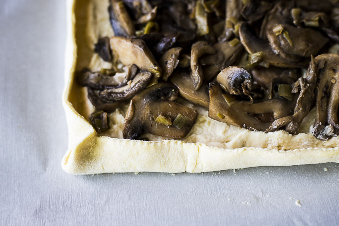 mushroom filled pie crust with edges pinched together