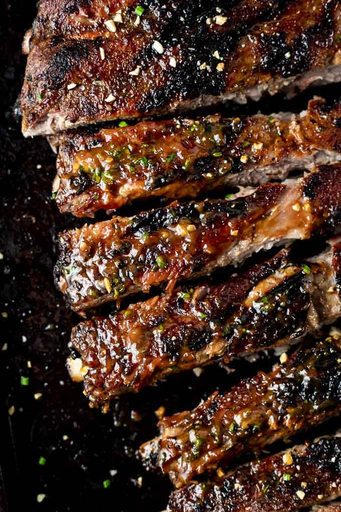 sliced bbq pork spare ribs on a platter