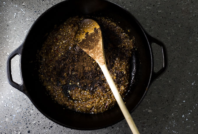 browned spice paste in a dutch oven