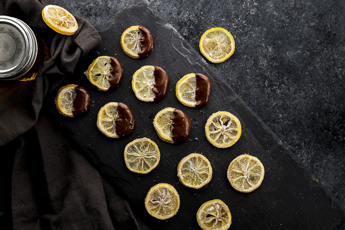 lemon slices on a plate dipped in chocolate