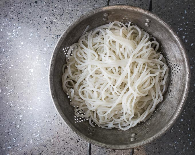 rice noodles in a colander