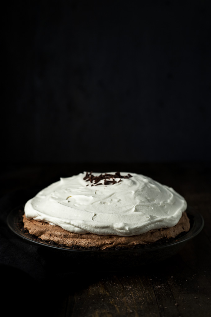 chocolate mousse pie covered in whipped cream