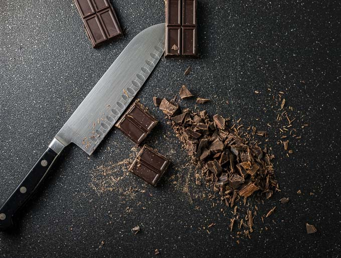 chopped chocolate pieces with knife