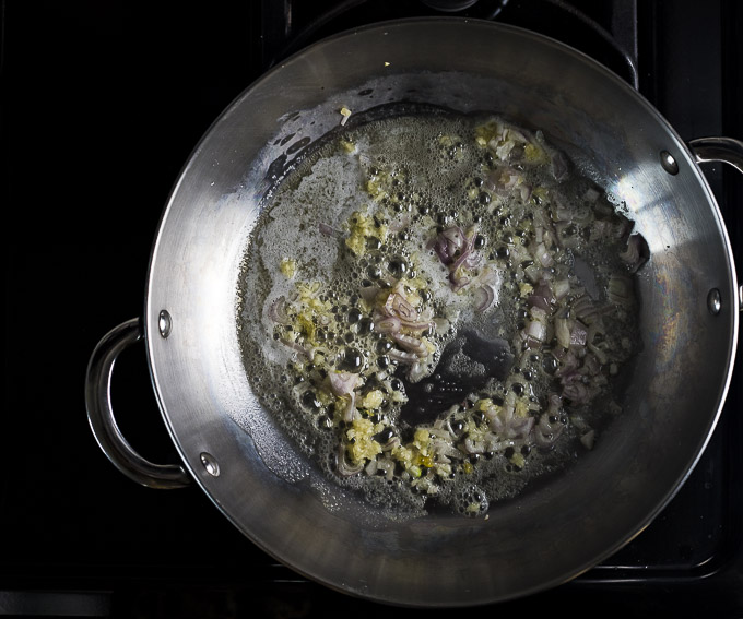 garlic and shallots with butter in a saute pan