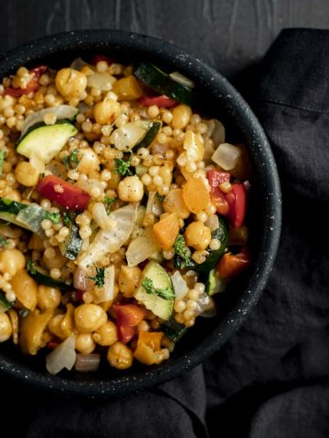 bowl of couscous with chickpeas and vegetables