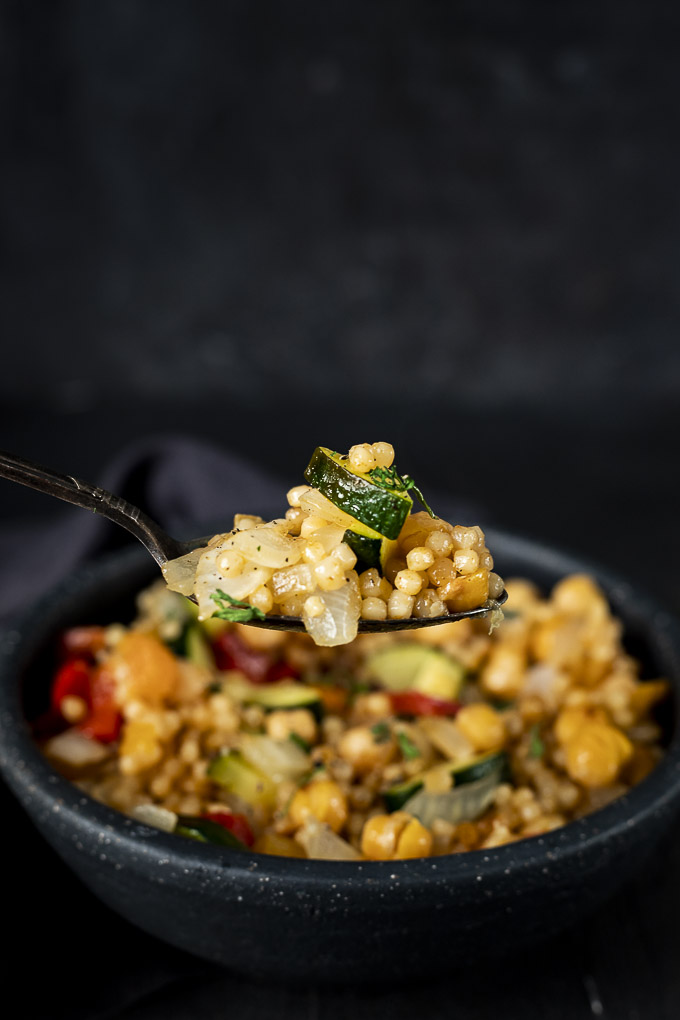 a spoonful of couscous with vegetables