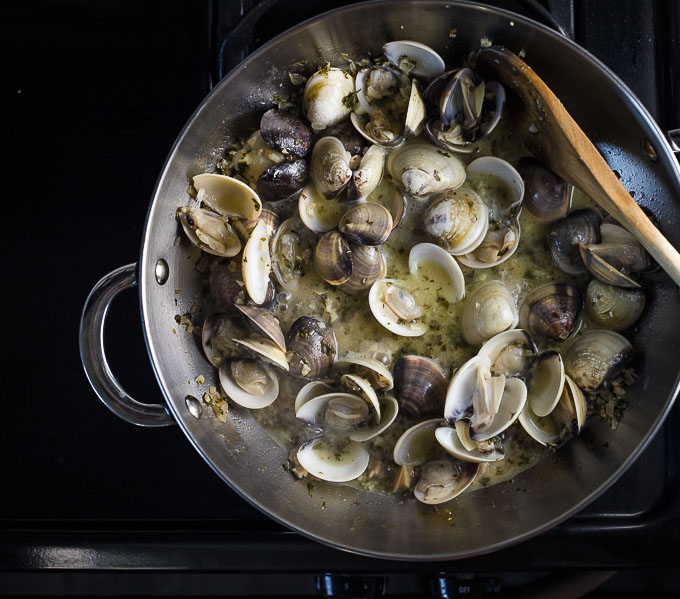 fresh cooked white clam sauce in a saute pan
