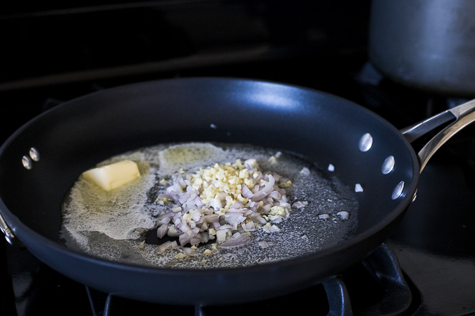 garlic and shallots in a skillet
