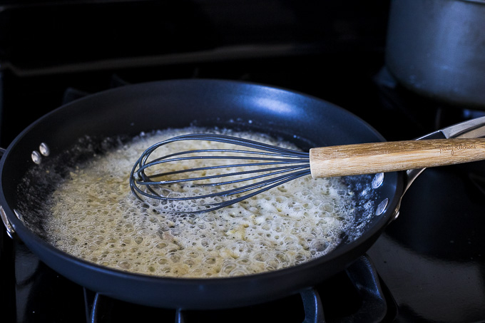 butter and flour in a skillet with a whisk