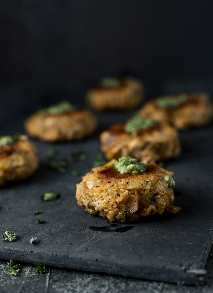 salmon cakes on a platter - side view