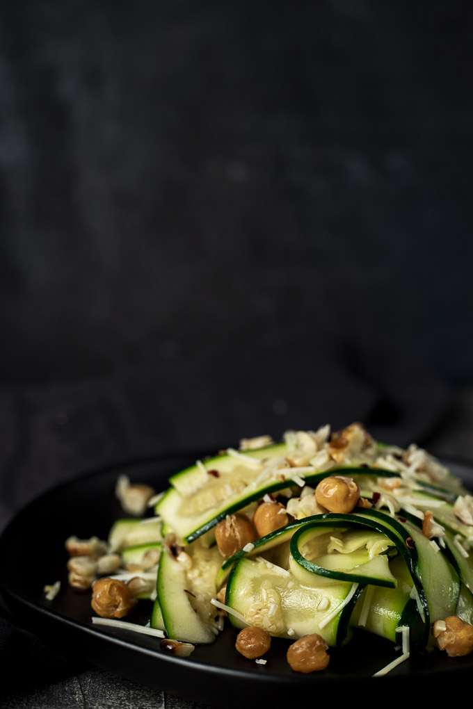 close up view of raw zucchini salad with cheese and chickpeas