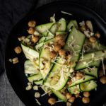 zucchini salad with chickpeas and parmesan cheese on a plate