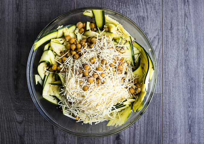 zucchini slices, parmesan cheese and garbanzo beans in a bowl