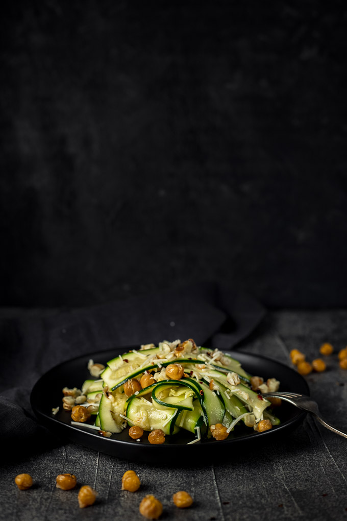 zucchini salad on a plate garnished with chikpes