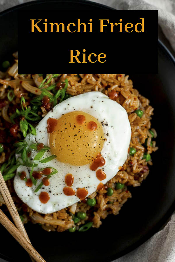 Packed with spicy kimchi, crispy salt pork, pepper, garlic and veggies, this Kimchi Fried Rice is super easy to make and absolutely incredible. This Korean Fried Rice has so many incredible flavors, and is one the table in less than 20 minutes! It\'s so easy to make. Plus, there are so many different variations to this easy fried rice recipe, you definitely want to be making this!! #wenthere8this #kimchifriedrice #friedricerecipe #kimchirice