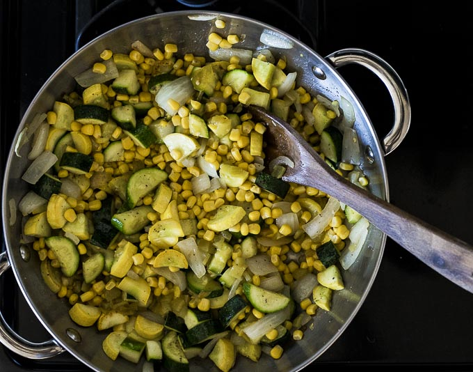 squash and corn cooking in a skillet