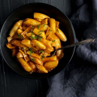 korean rice cakes in an orange sauce