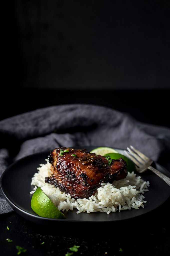roasted chicken on a bed of rice with lime slices