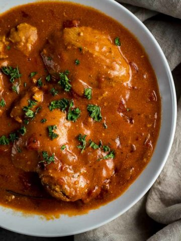 chicken in orange sauce with parsley on top