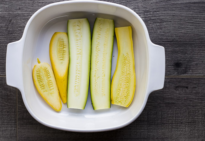 slices of raw squash in a baking dish