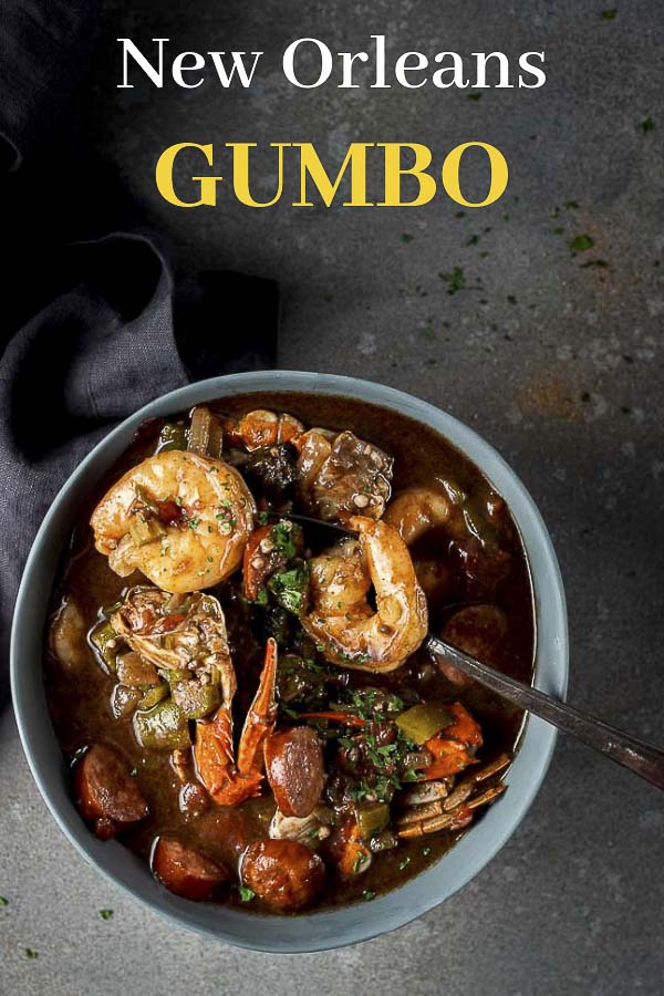 This New Orleans Gumbo recipe is made with spicy smoked andouille sausage, crab, shrimp, oysters, okra and vegetables, all served over steamed white rice. Learn how to make seafood gumbo in just a few easy steps, and all in under an hour! This easy gumbo recipe is the ultimate in comfort food! #wenthere8this #seafoodgumbo #neworleansgumbo #louisianagumbo