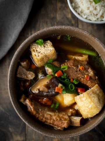 bowl of soup with ribs, mushrooms, tofu and chilies