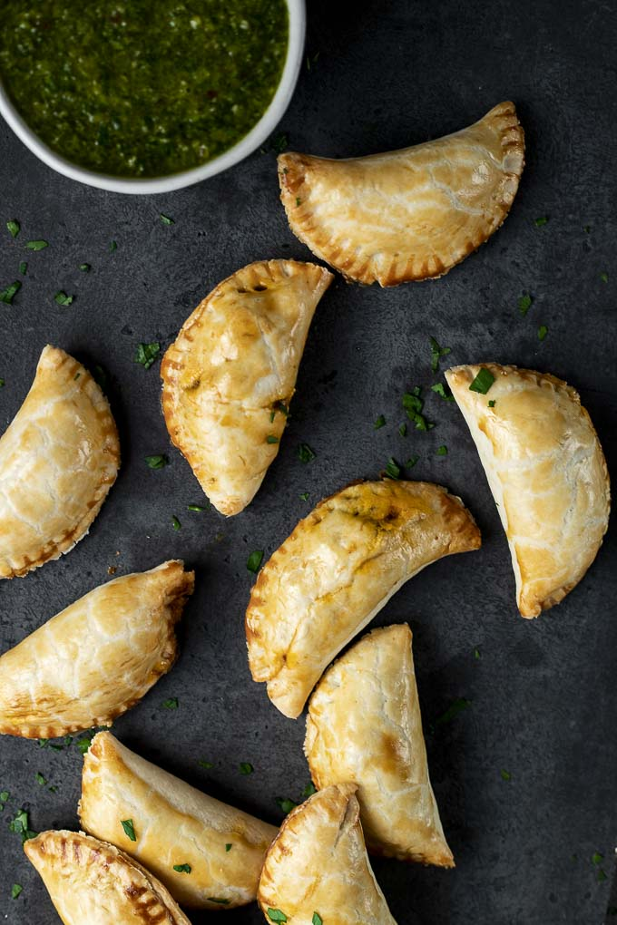 empanadas with chimichurri sauce on the side