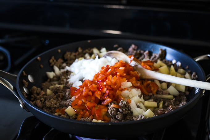 ground beef and red peppers in a skillet