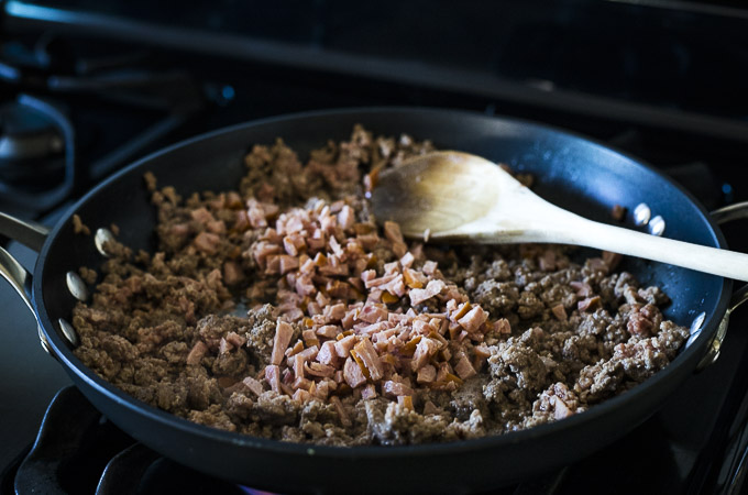 cooked ground beef and sausage in a skillet