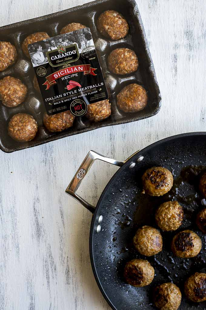 package of meatballs and cooked meatballs in a pan