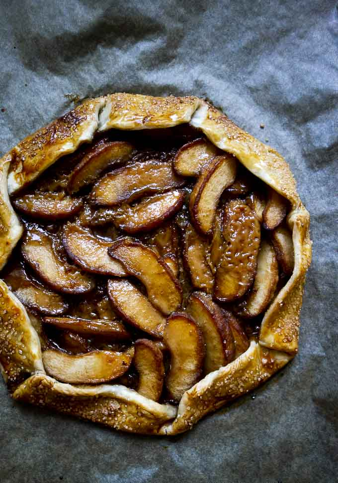 full baked apples galette on parchment paper