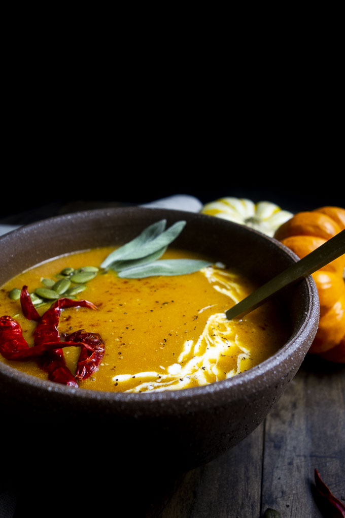 bowl of orange soup with spoon