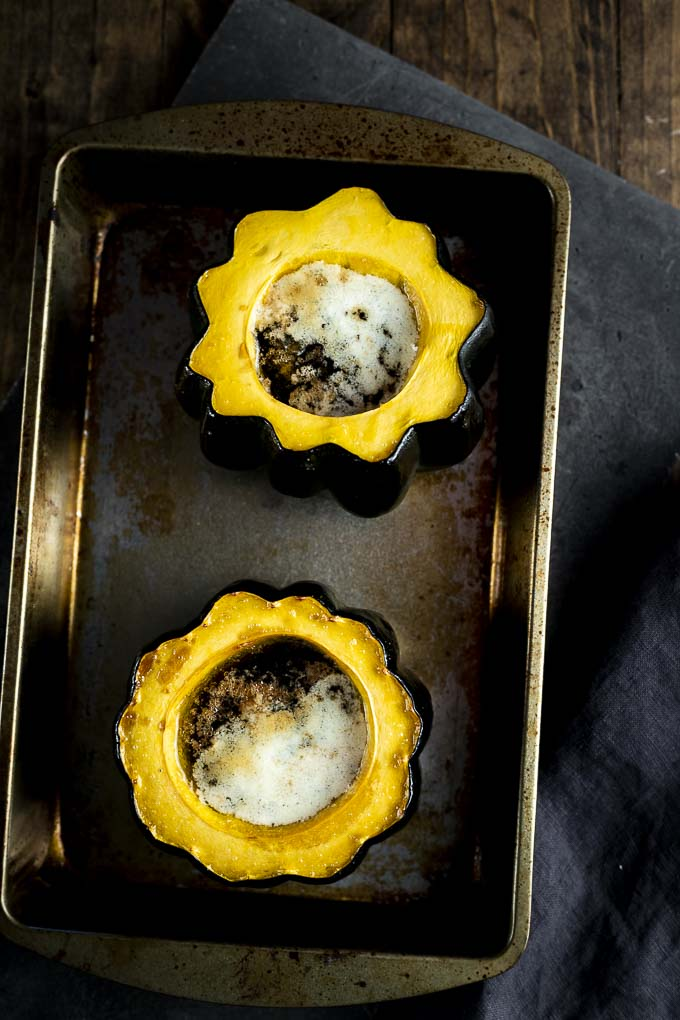 2 roasted acorn squash halves filled with butter and brown sugar