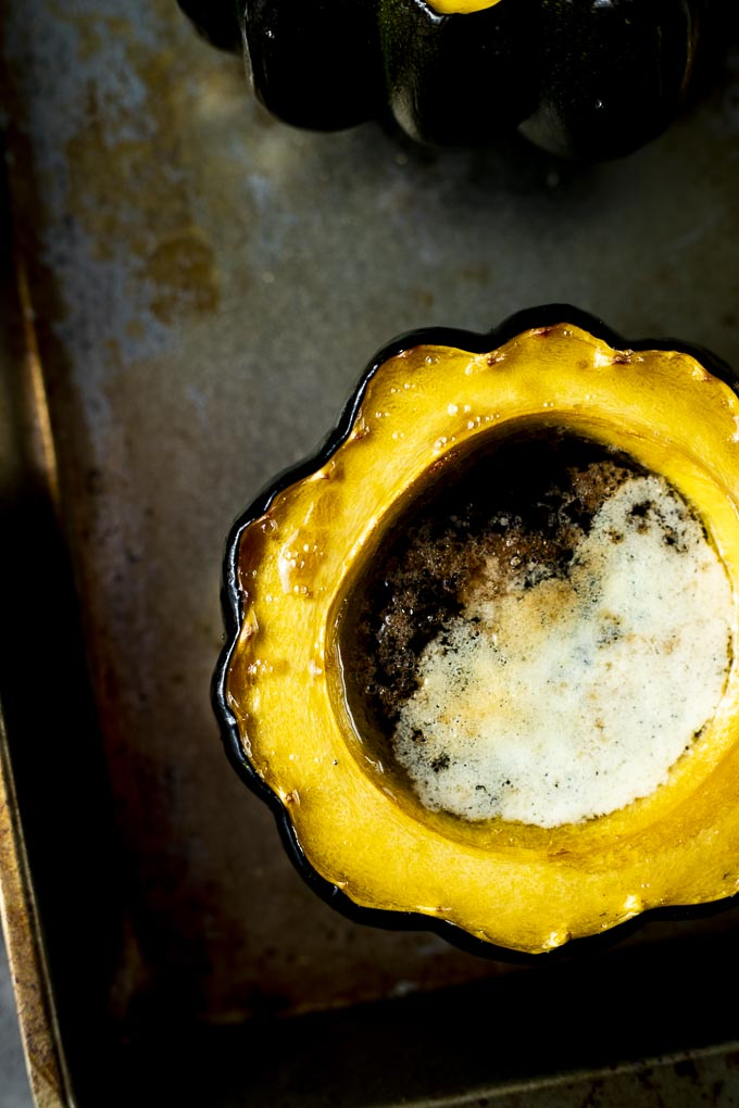 roasted acorn squash half with melted butter in middle