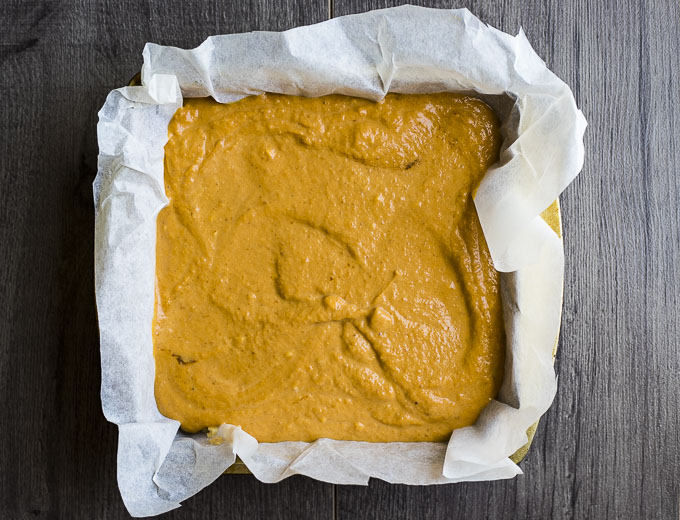pumpkin pie mixture in a square pan