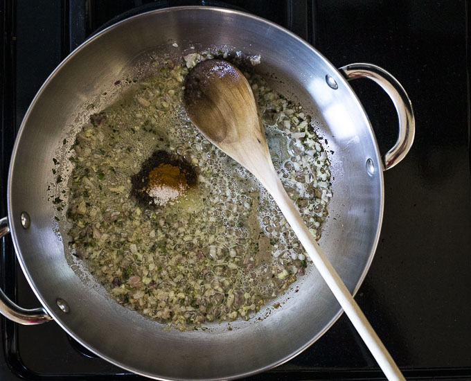 onions and spices in a saute pan