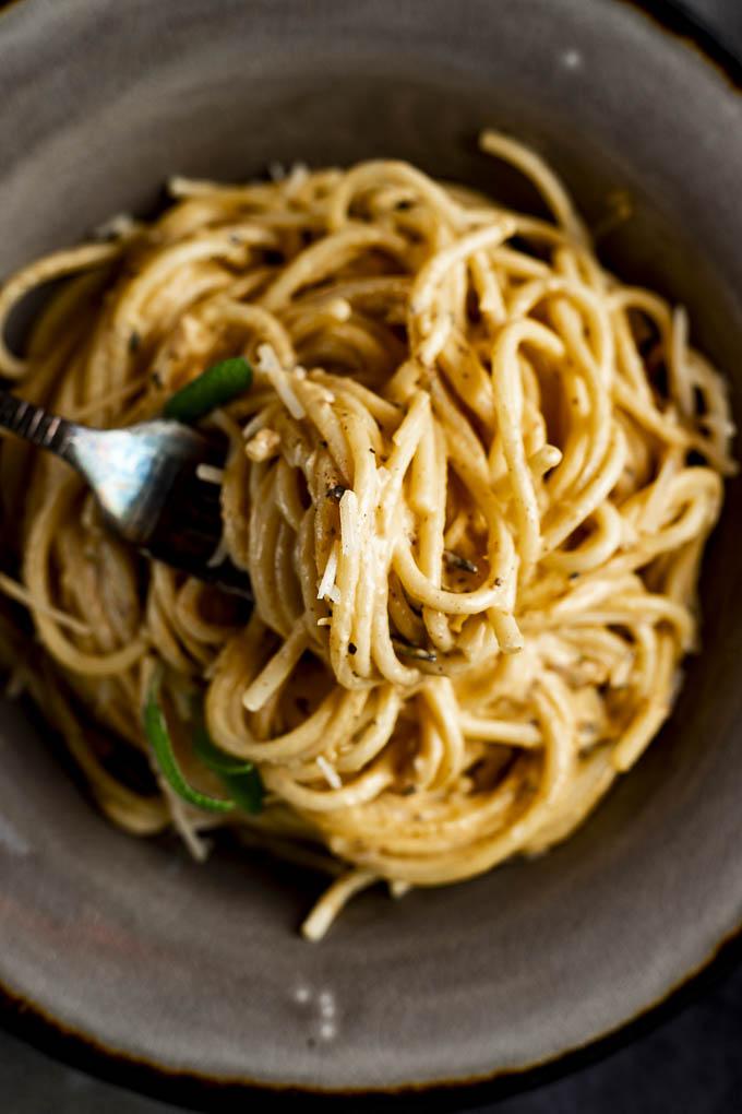 forkfull of pasta in cream sauce