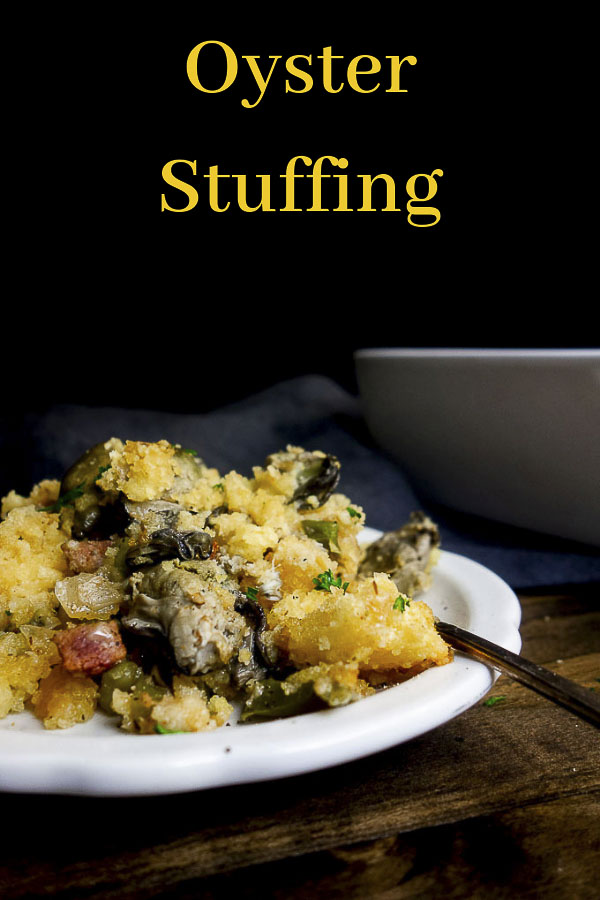This Oyster Dressing recipe is super simple to make & will absolutely blow away your guests with deliciously intense flavors! Oyster cornbread stuffing with Andouille sausage is something you NEED this holiday season. Super easy to make & packed full of flavor from the sweet cornbread, briny oysters, spicy Andouille sausage & cajun seasonings, this easy oyster stuffing is incredible! #oysterstuffing #thanksgivingstuffing #cornbreadstuffing #oysterdressing