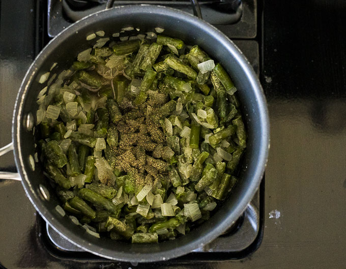 green beans and seasoning in a pot on the stove