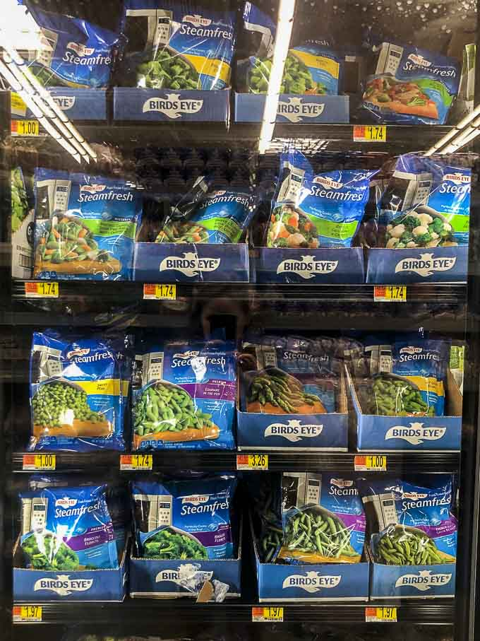 frozen vegetables in the freezer aisle of grocery store