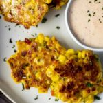 crispy corn fritters on a plate