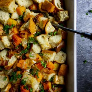 baking dish filled with stuffing made with butternut squash