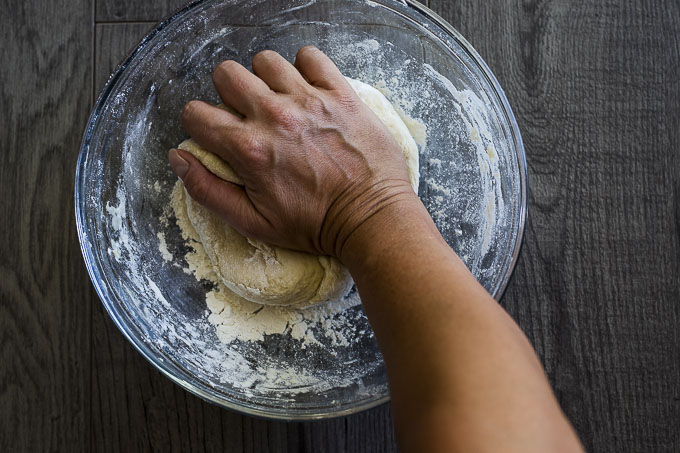 hand kneading pizza dough