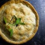 pie garnished with basil leaves