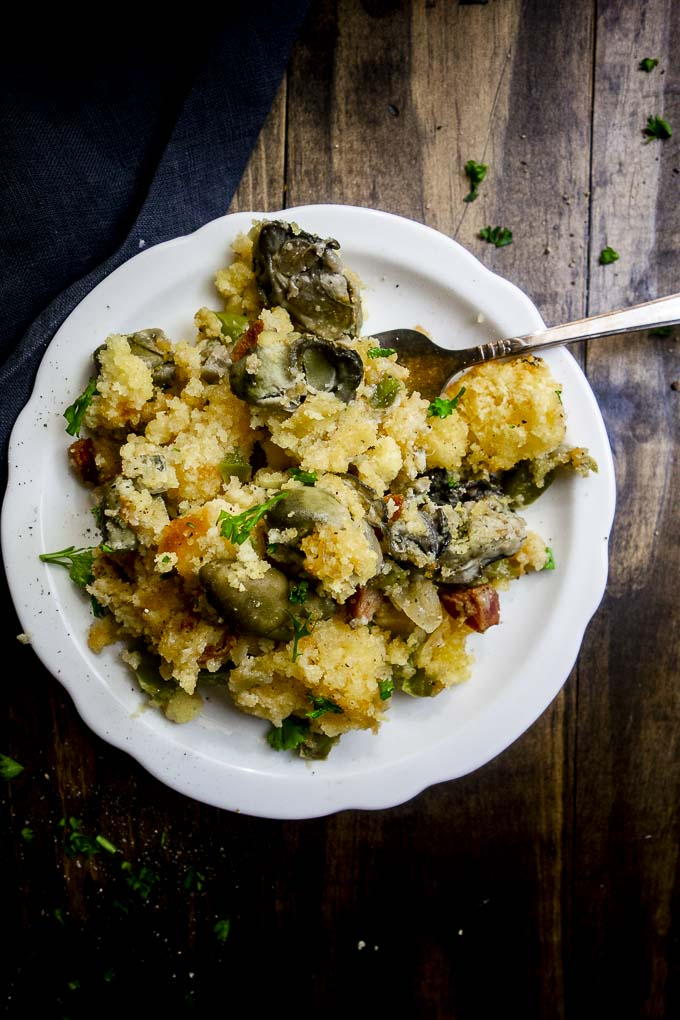 oyster cornbread stuffing on a plate with a fork