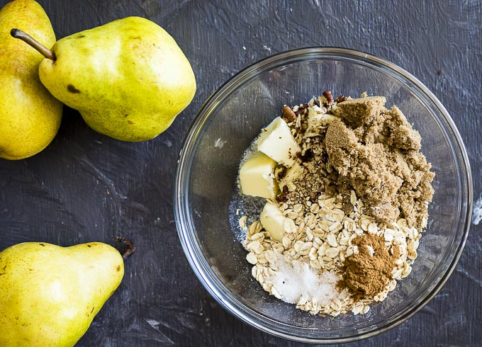 ingredients for pear crisp in a bowl