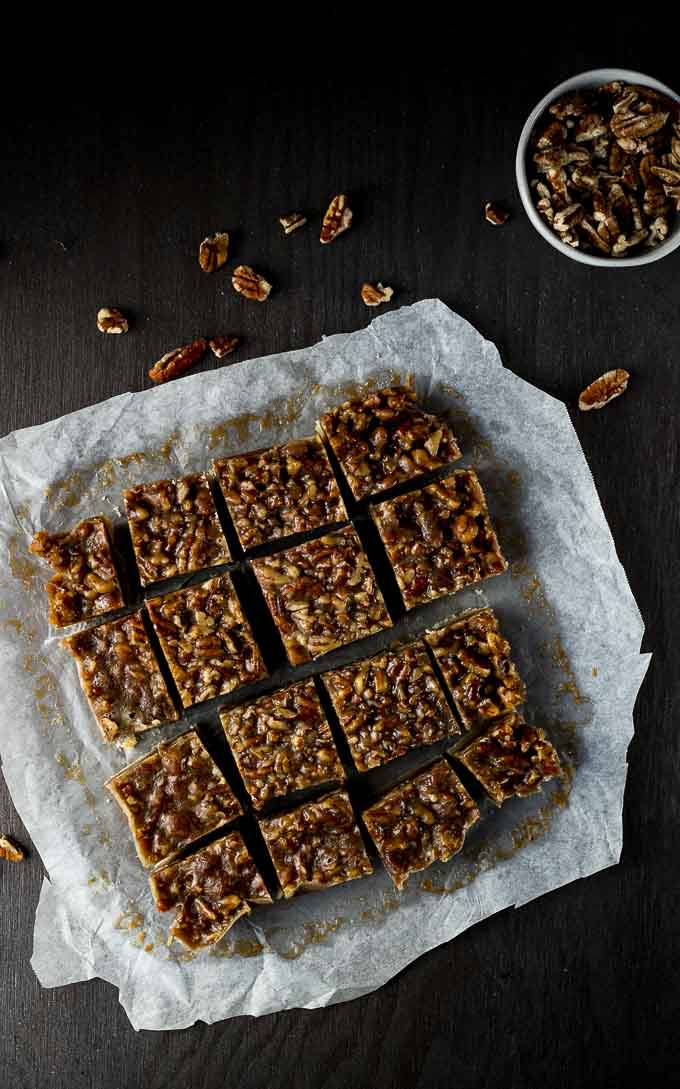 slced pecan pie bars on parchment paper