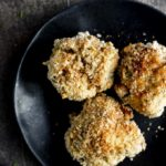 plate of 3 stuffing balls with breadcrumbs
