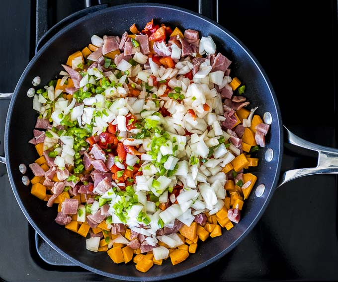 sweet potato and vegetables in a skillet